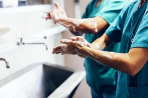 Healthcare workers wash hands